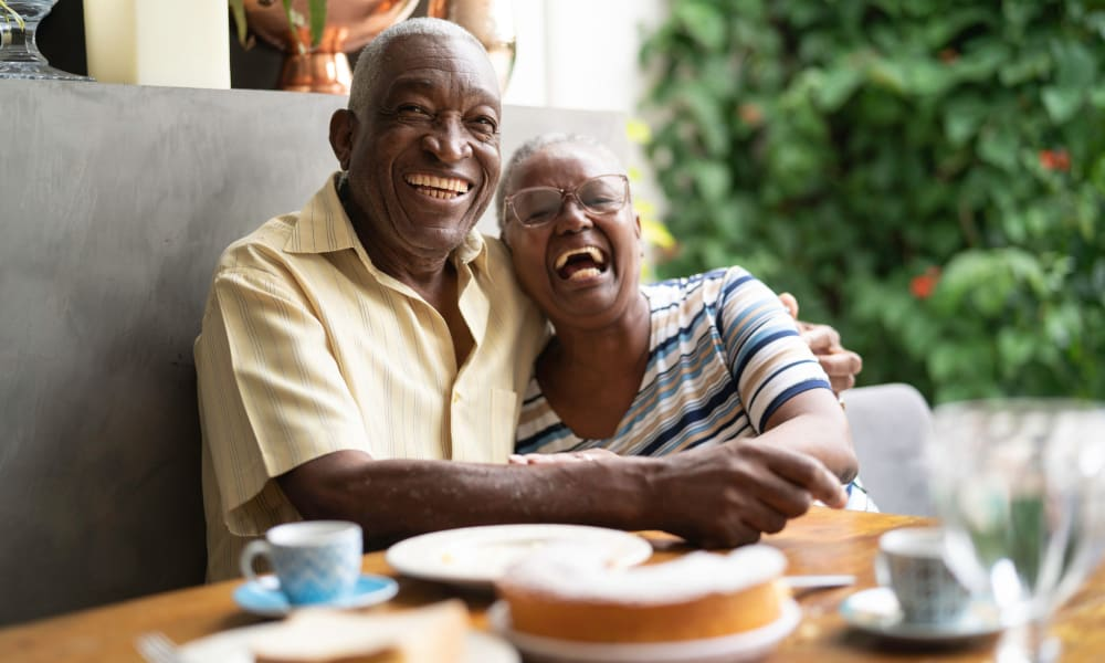 Resident couple hugging at a table in Randall Residence of Centerville in Centerville, Ohio