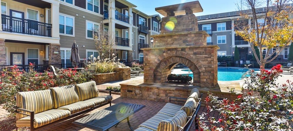 Beautiful outdoor seating and fireplace at Fountains at Mooresville Town Square in Mooresville, North Carolina