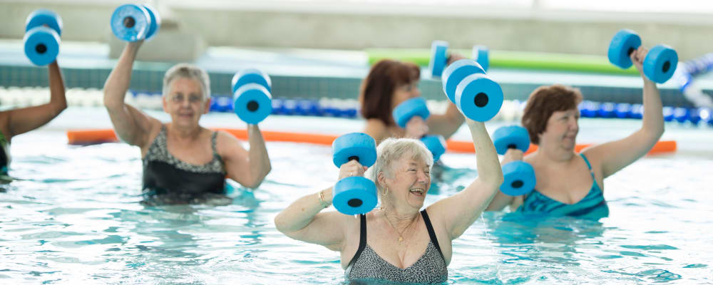 Residents engaged in a group swimming exercise at The Springs at Lake Oswego in Lake Oswego, Oregon