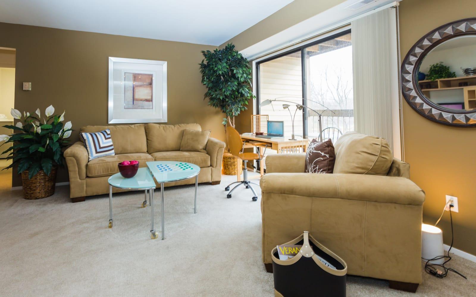 Model living room at Fairmont Park Apartments in Farmington Hills, Michigan