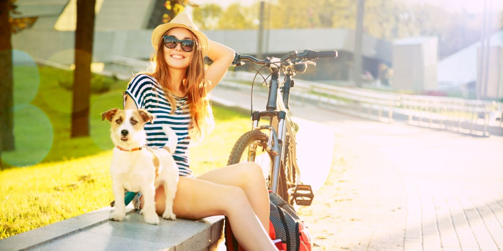 Resident and her dog enjoying the sun near their new home at Doral View Apartments in Miami, Florida