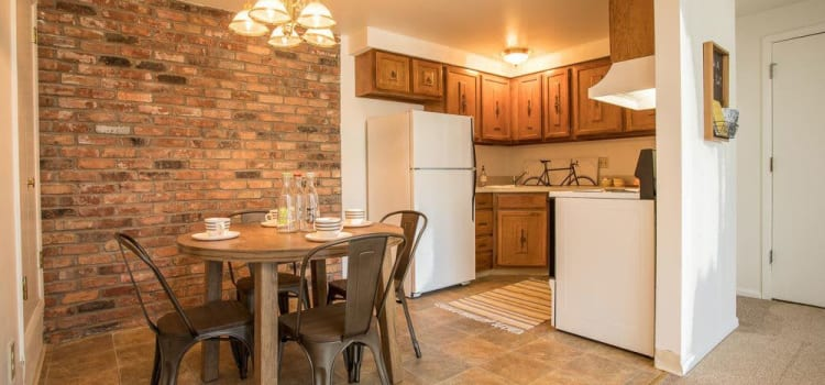 Well-equipped kitchen and dining room at Idylwood Resort Apartments home