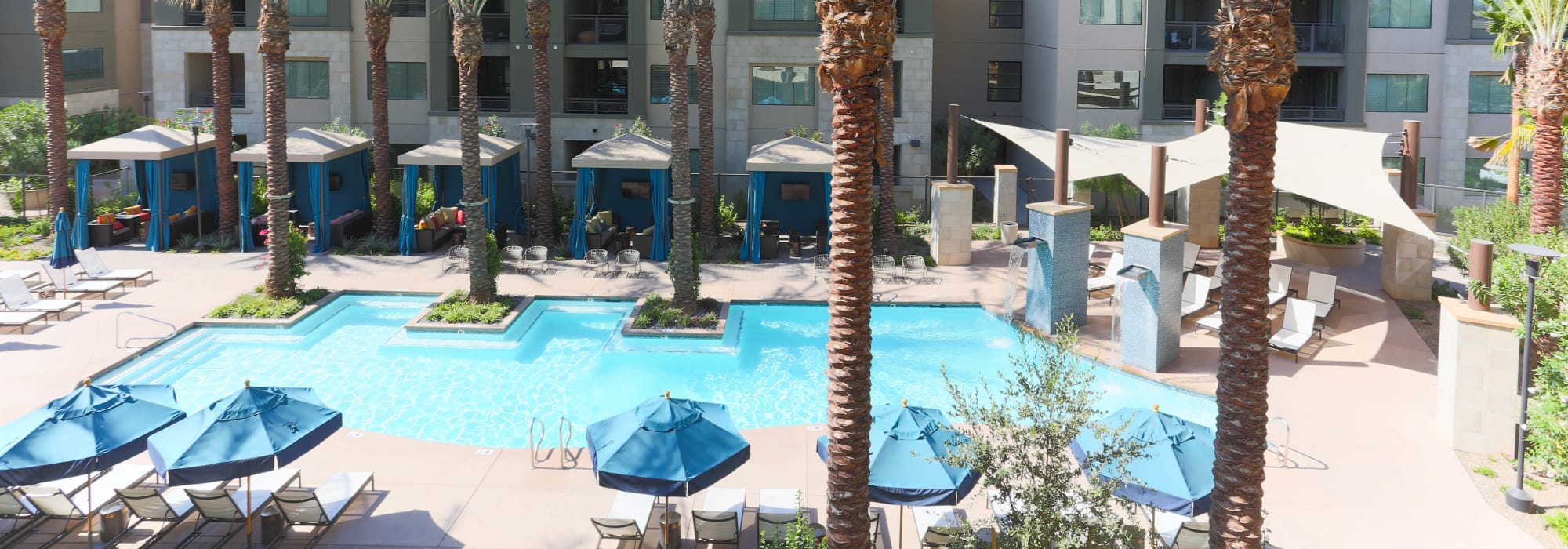 View of the pool area from an upper-floor balcony at Avant at Fashion Center in Chandler, Arizona