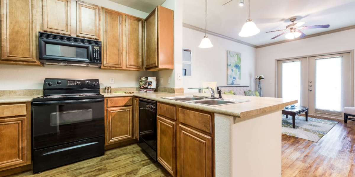 Bright kitchen with wood flooring at Marquis at Clear Lake in Webster, Texas
