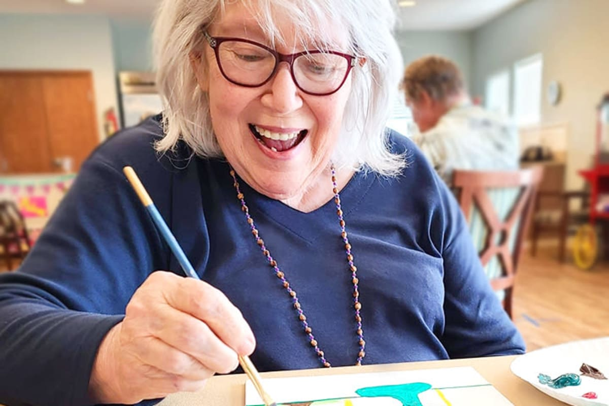 A resident painting at The Oxford Grand Assisted Living & Memory Care in McKinney, Texas