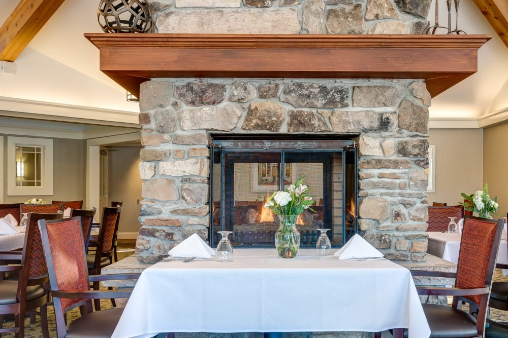 Table near fireplace at Maplewood at Orange in Orange, Connecticut