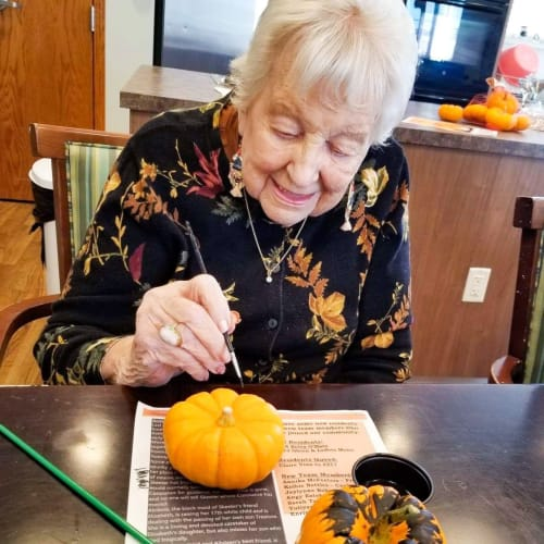 Resident filling out a questionnaire at The Oxford Grand Assisted Living & Memory Care in Wichita, Kansas