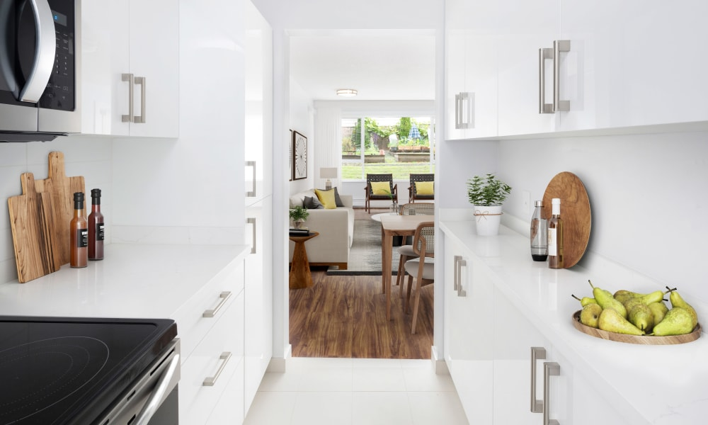 Model kitchen with white finishes at Larchway Gardens in Vancouver, British Columbia