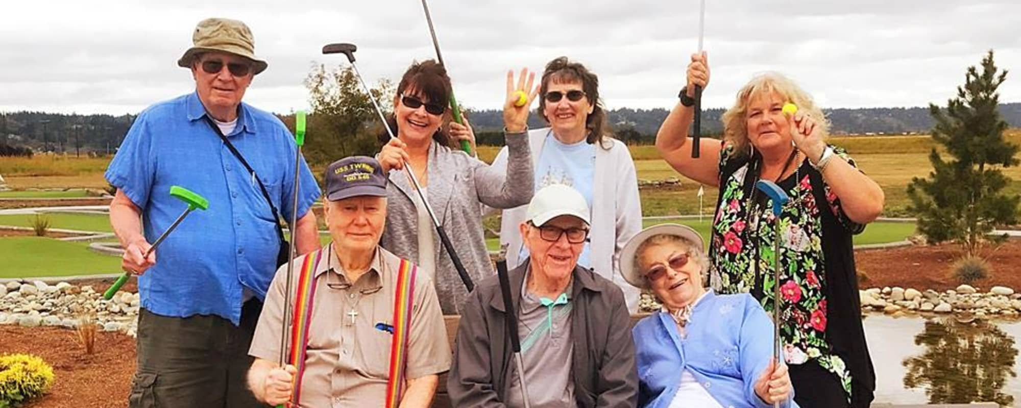 Seniors playing mini golf together at The Creekside in Woodinville, Washington
