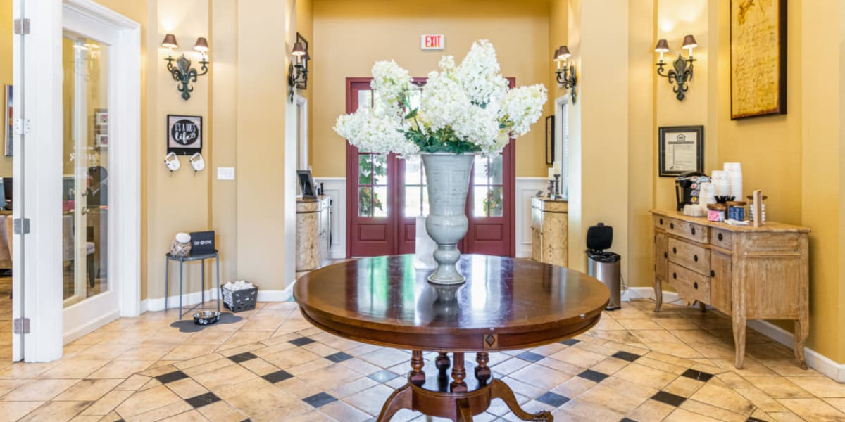 Lobby entrance with self-serve coffee area at Marquis of Carmel Valley in Charlotte, North Carolina