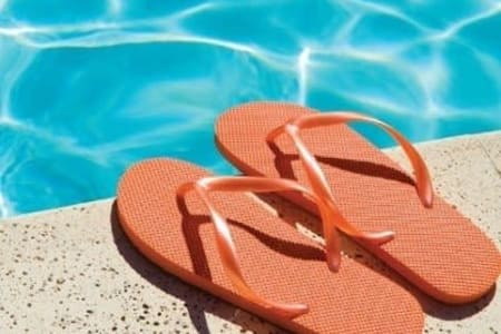 Flip flops sitting near Woodland Acres Townhomes's swimming pool in Liverpool, New York