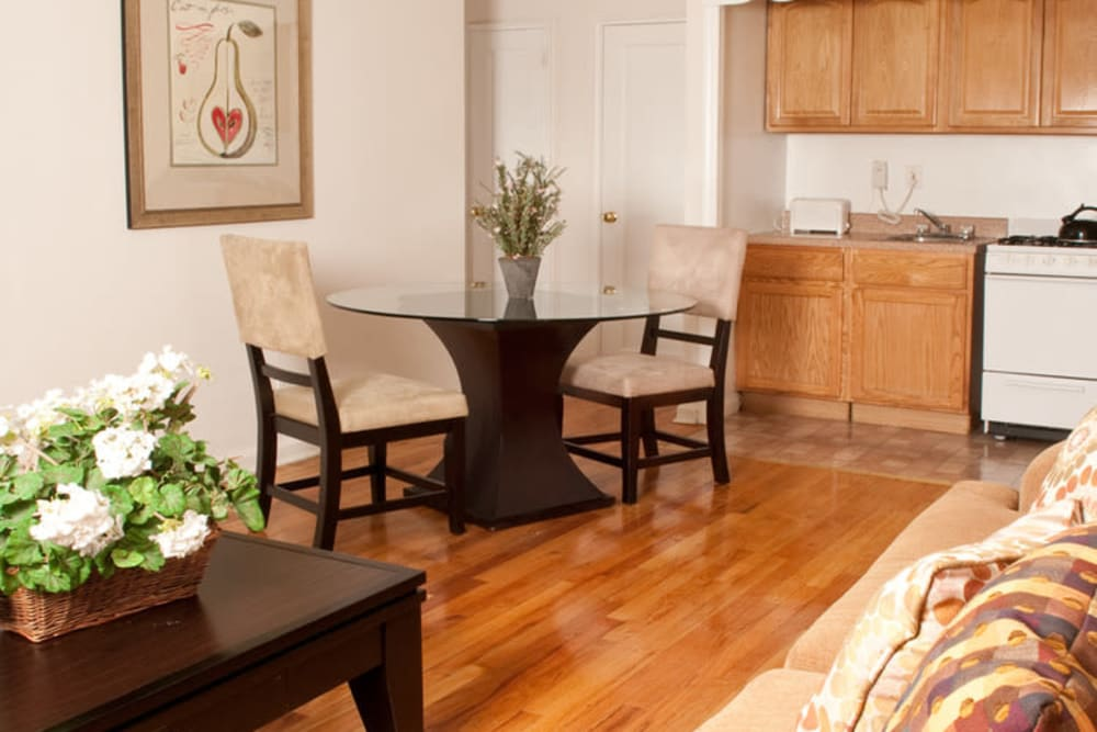 Living room and kitchen at King Alfred Apartments in Passaic, New Jersey