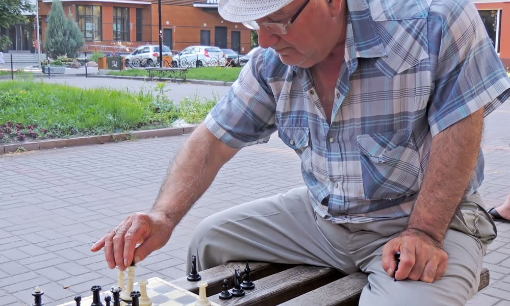 A resident playing chess outside near Honeysuckle Senior Living in Hayden, Idaho