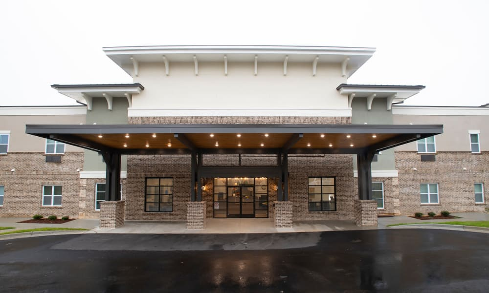 Front entrance and parking lot for The Mansions at Gwinnett Park Assisted Living and Memory Care in Lawrenceville, Georgia