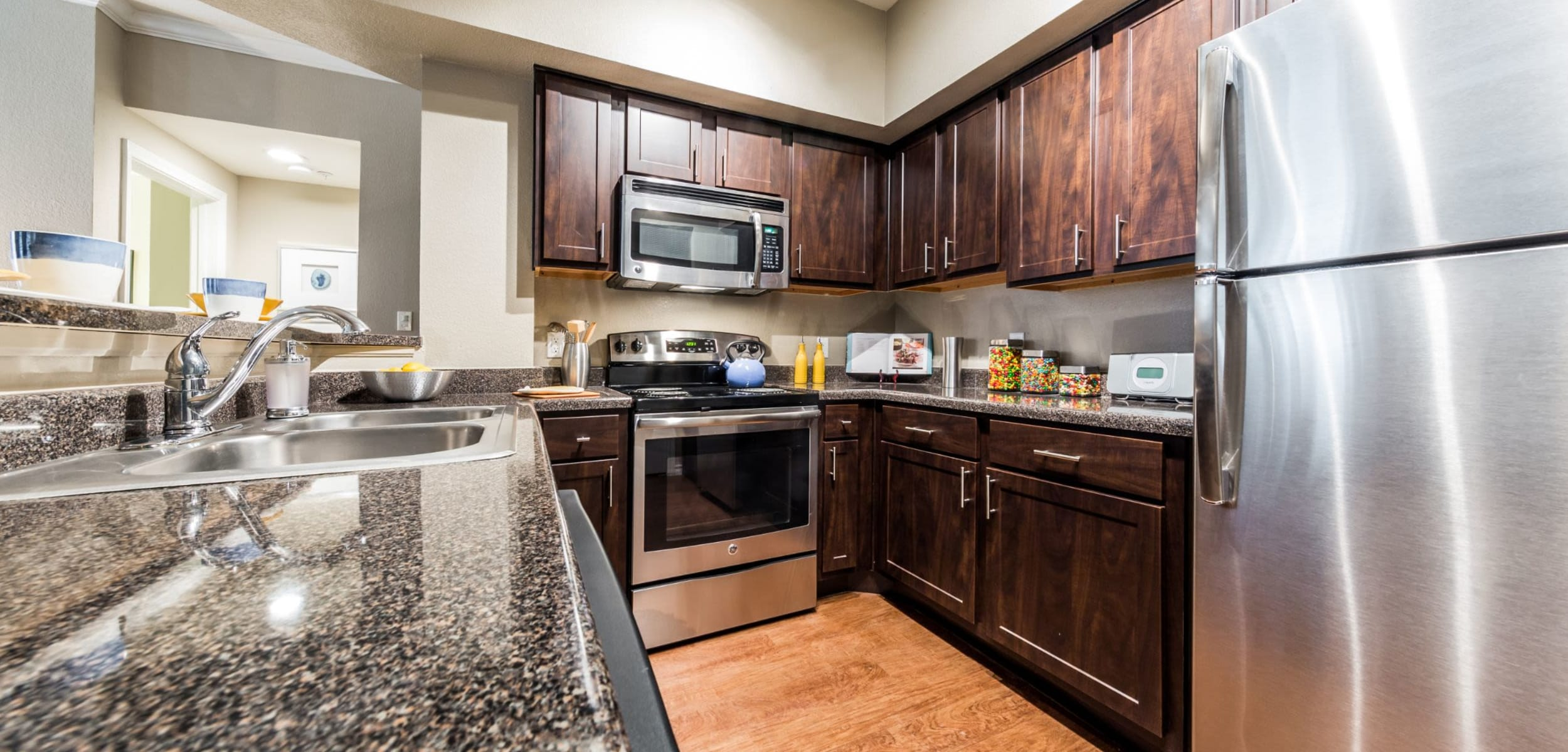 Kitchen with dark colored cabinets Marquis at Deerfield in San Antonio, Texas