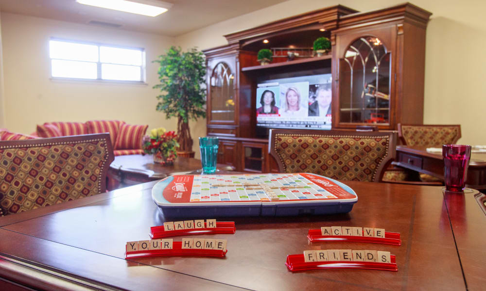 Scrabble on a table in the game room at Julian Estates Gracious Retirement Living in Puyallup, Washington