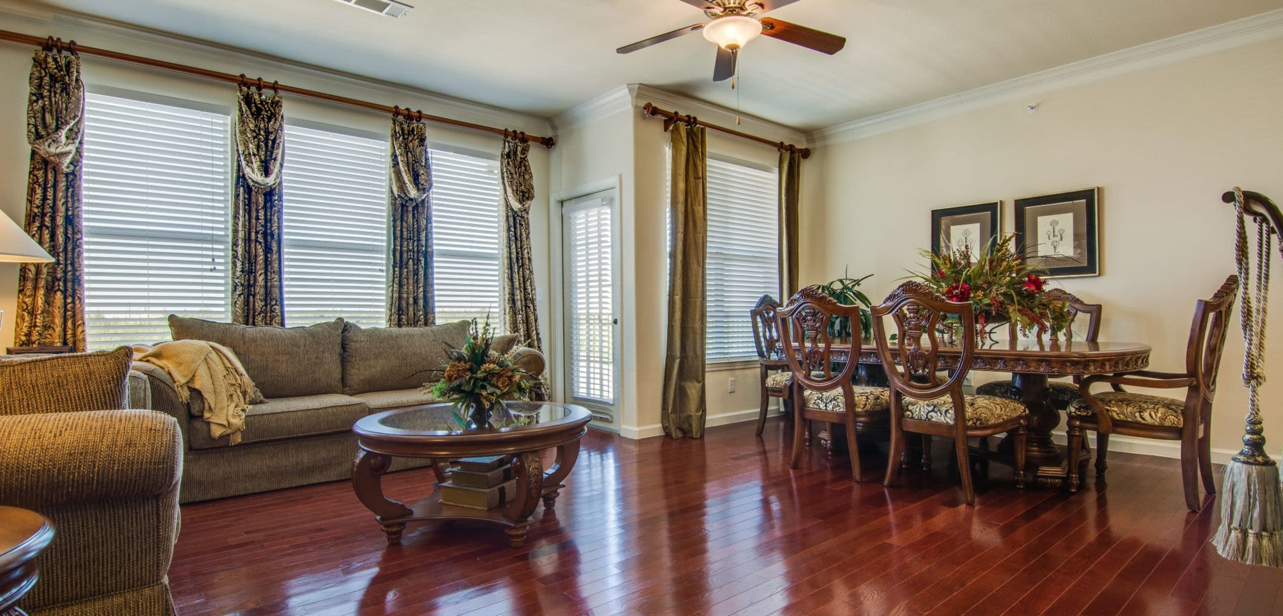 Living space with wood style floors at Marquis Rockwall in Rockwall, Texas