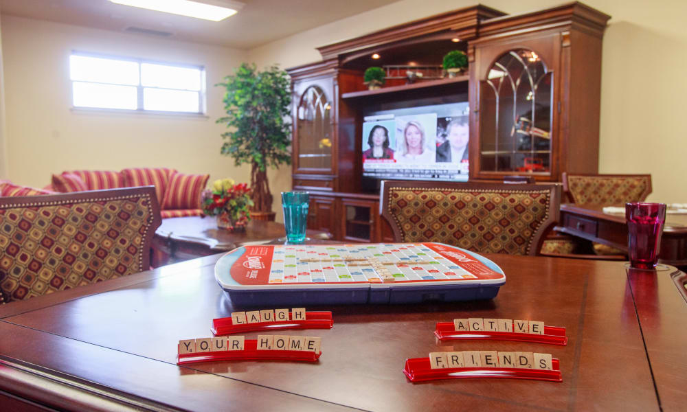 Activities room with a game of Scrabble going at Ashton Gardens Gracious Retirement Living in Portland, Maine
