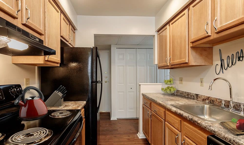 Modern kitchen at Steeplechase Apartments home in Camillus, NY