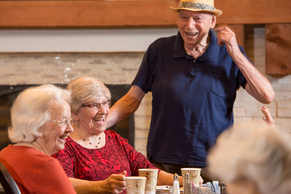 People laughing and having coffee at Isle at Cedar Ridge in Cedar Park, Texas