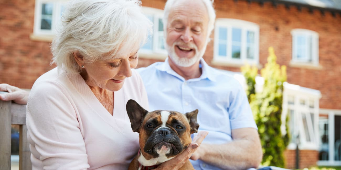 Residents and their dog at a Merrill Gardens community.