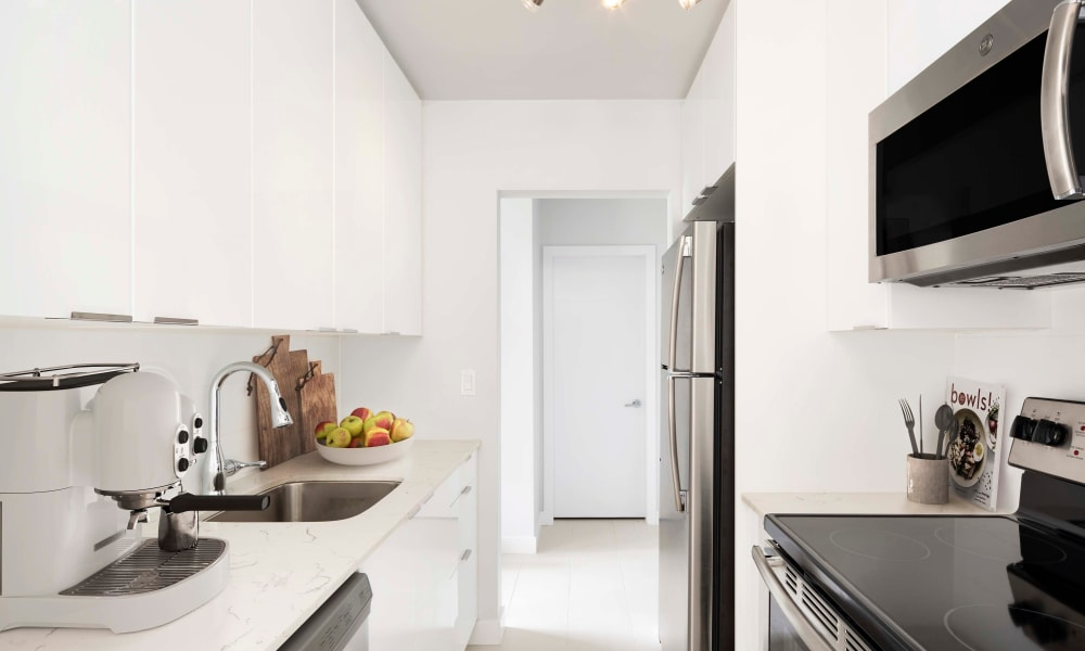 Lovely kitchen with stainless steel appliances at Fraser Tolmie Apartments in Victoria, British Columbia
