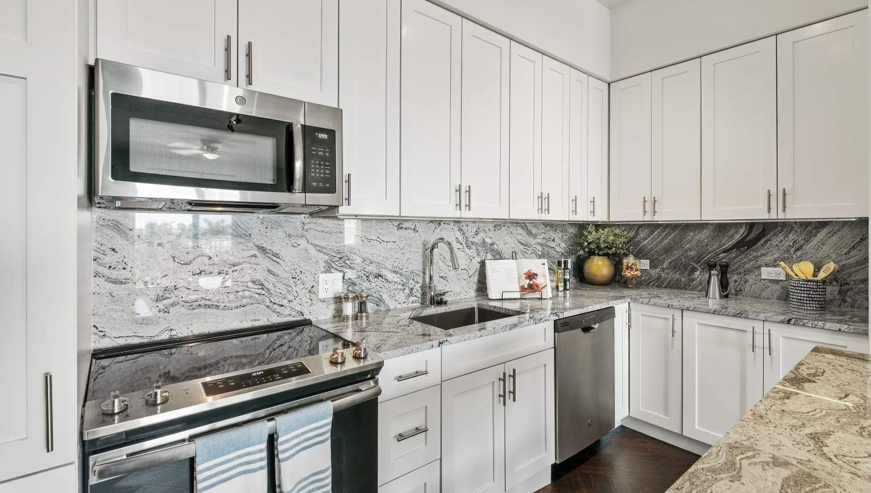 Model kitchen with European style cabinets and quartz countertops at Town Lantana in Lantana, Florida