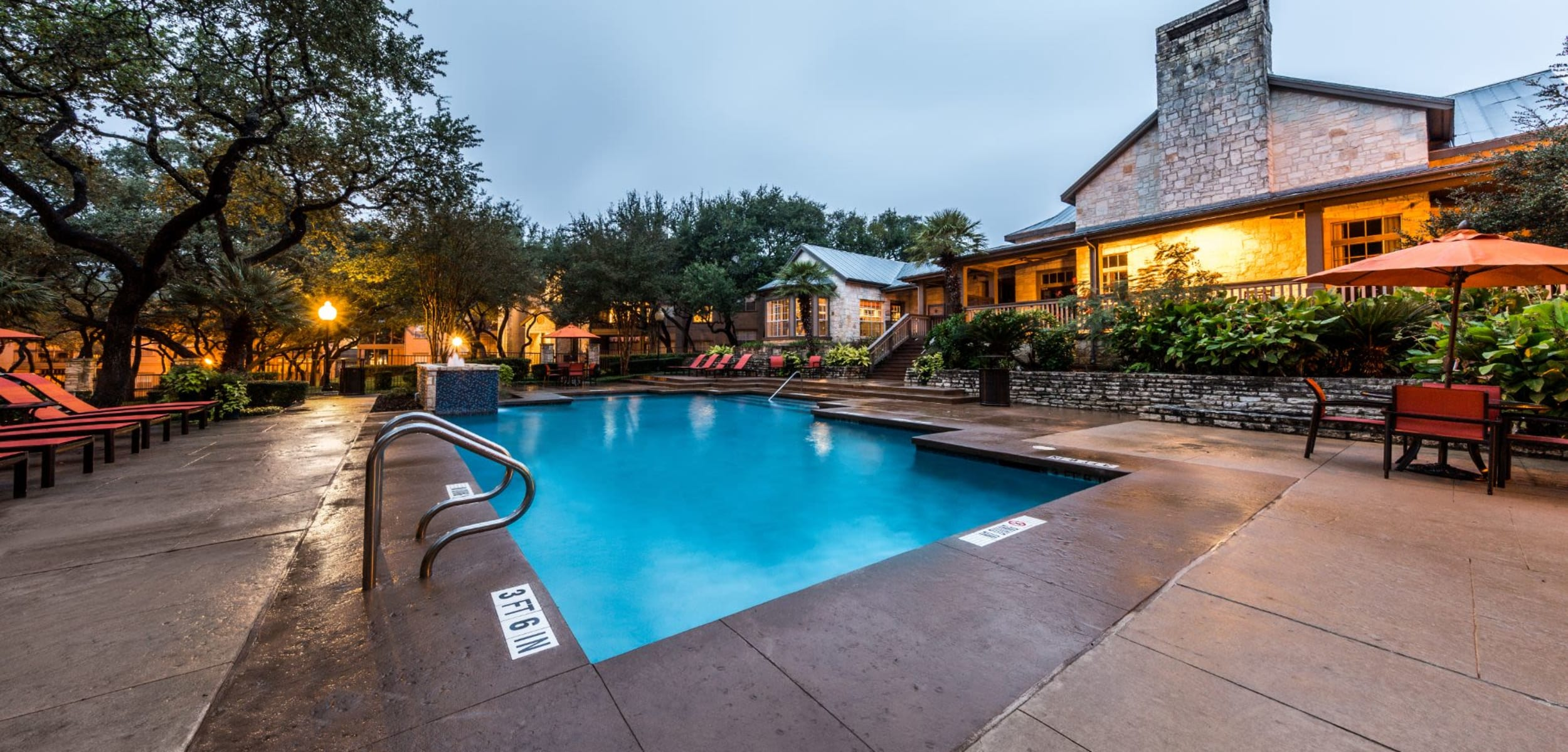 Swimming pool with sun chairs at Marquis at Deerfield in San Antonio Texas,