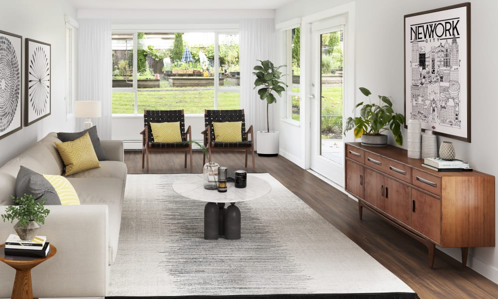 Beautiful living room with hardwood flooring at Larchway Gardens in Vancouver, British Columbia