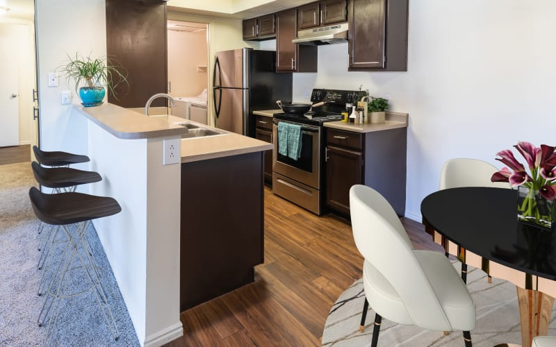 Fully equipped kitchen with stainless steel appliances at Shadowbrook Apartments in West Valley City, Utah