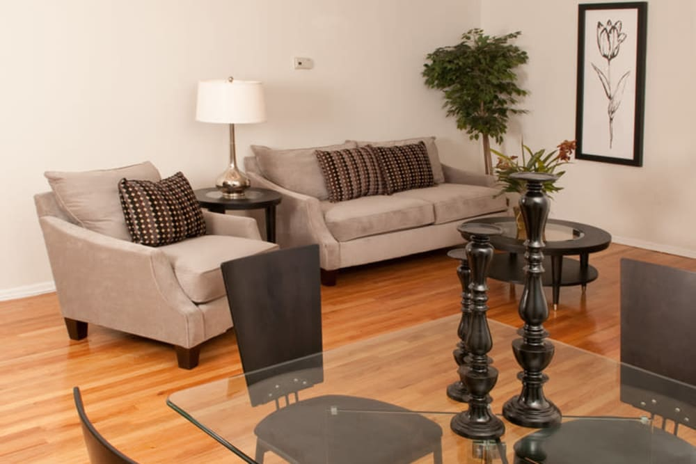 Living room with hardwood floors at Lafayette Park Apartments in Hawthorne, New Jersey