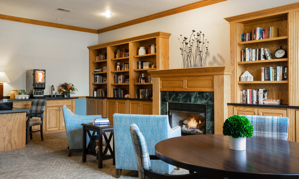 Lounge area with a fireplace at Randall Residence of Decatur in Decatur, Illinois