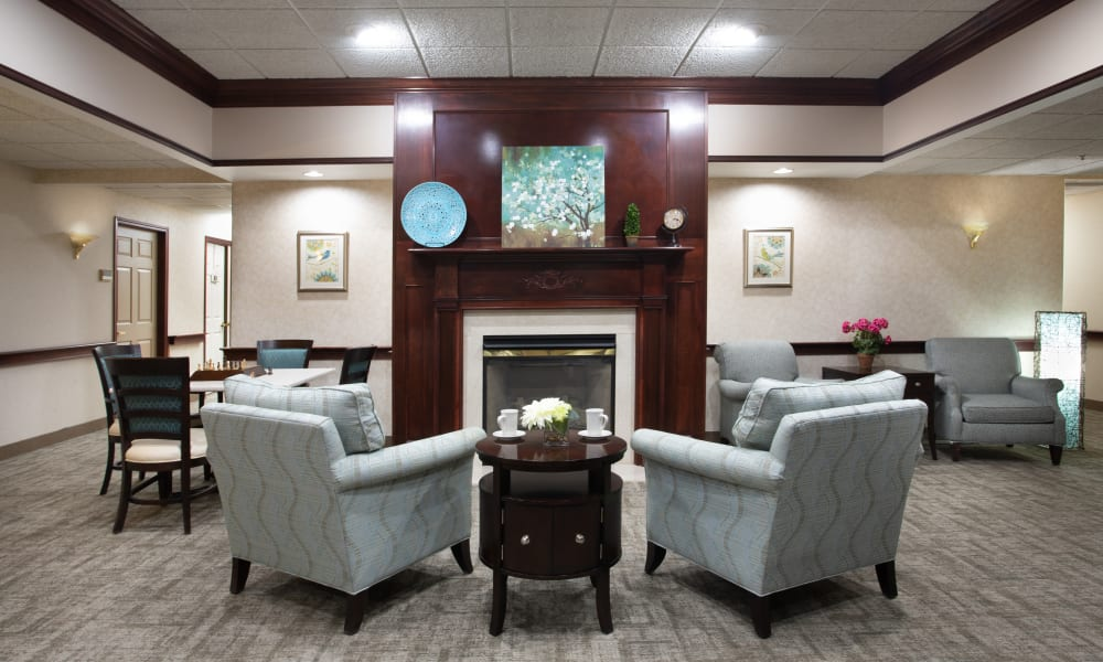 Lounge with lots of seating and a fireplace at Governor's Pointe in Mentor, Ohio