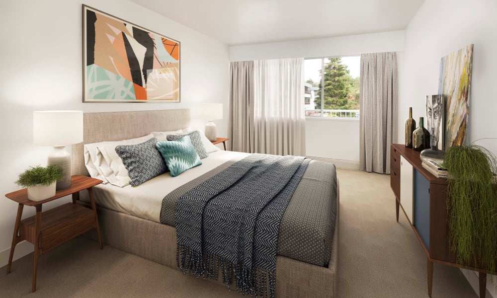 Modern bedroom with lovely art at Fraser Tolmie Apartments in Victoria, British Columbia