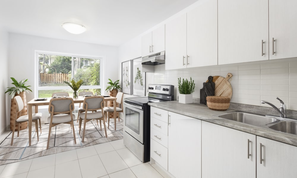 State-of-the-art kitchen with white cabinetry at Bayview Mews in North York, Ontario