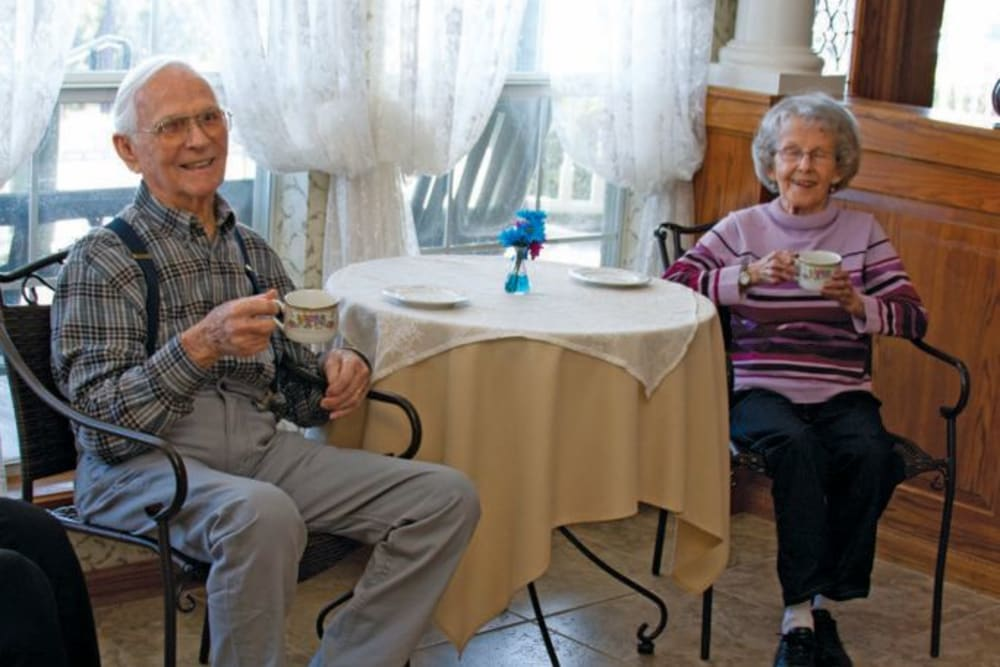 Residents sitting and drinking tea at Quail Park of Granbury in Granbury, Texas