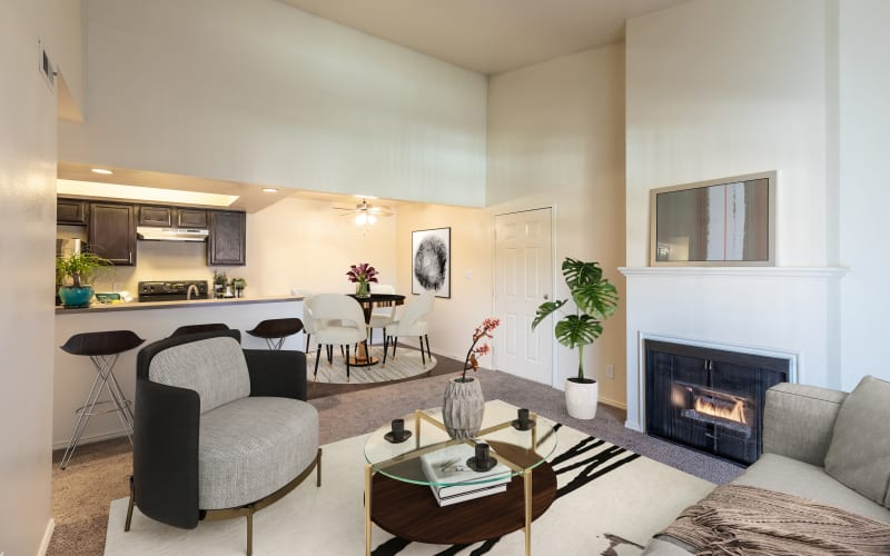 Living room with a fireplace and high ceilings at Shadowbrook Apartments in West Valley City, Utah