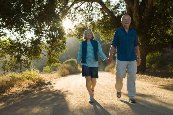 Couple holding hands and walking at The Gardens at Creekside