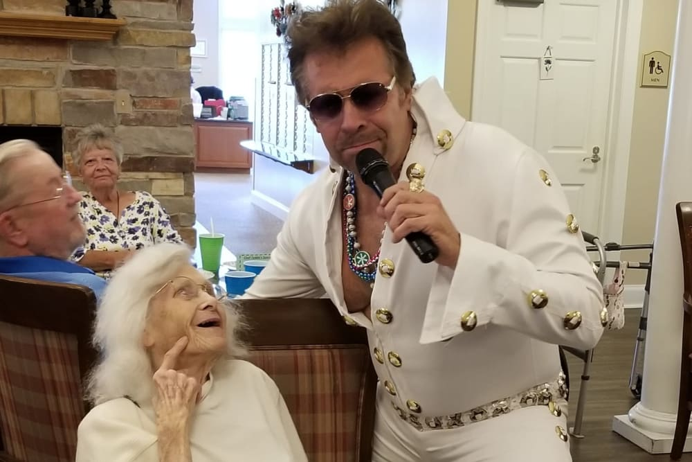 A resident enjoying a visit from Elvis at The Meadowlands in O'Fallon, Missouri