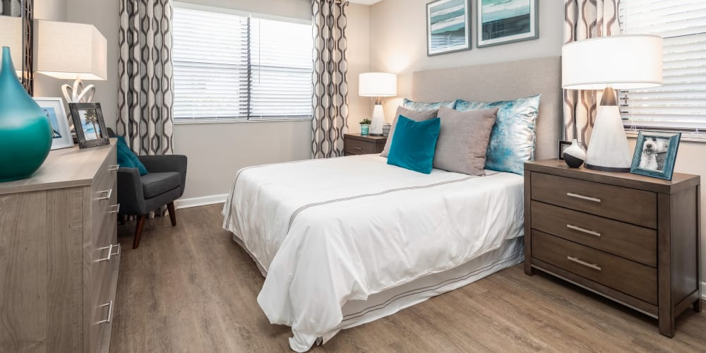 Well lit bedroom with tons of open space and wood style flooring at The EnV in Hollywood, Florida
