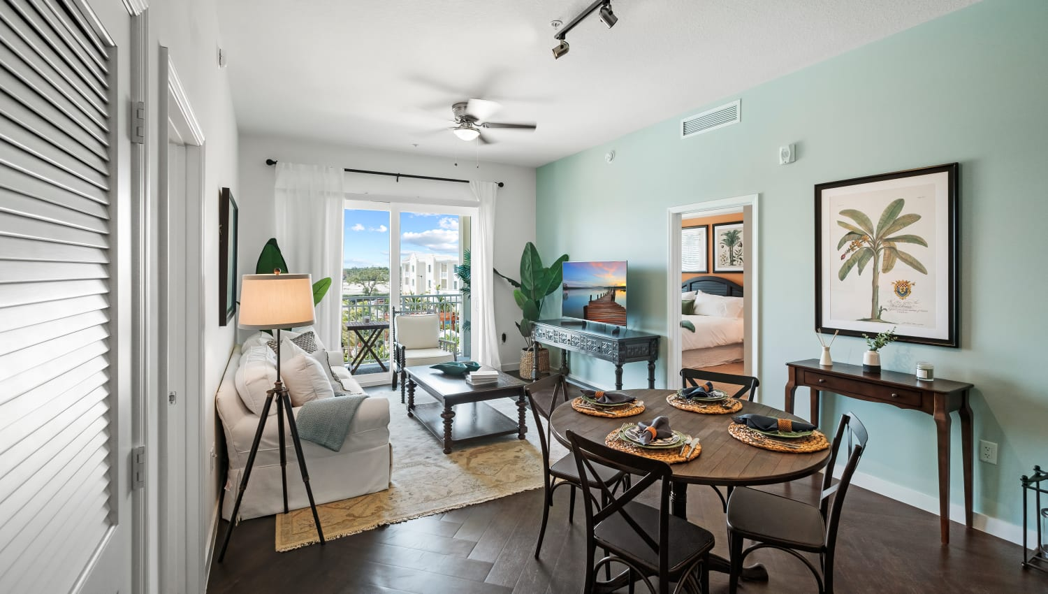 Dining and living area in a model home at Town Lantana in Lantana, Florida