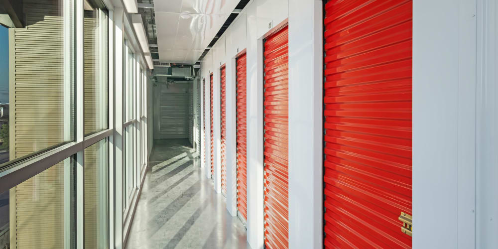 Indoor units with red doors at StorQuest Self Storage in Paramount, California