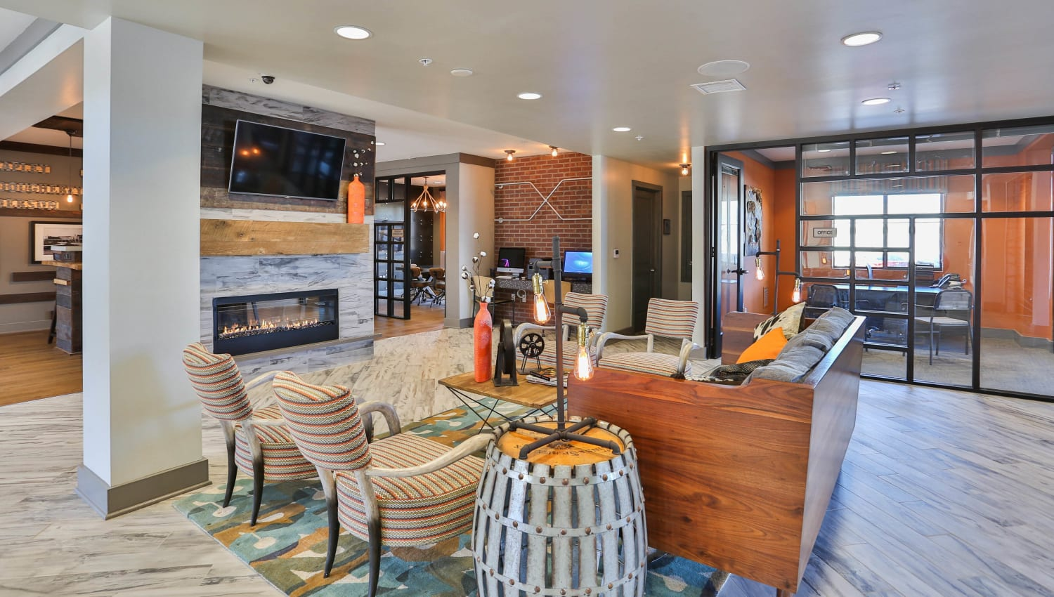 Comfortably furnished lounge area in the resident clubhouse at Olympus Steelyard in Chandler, Arizona
