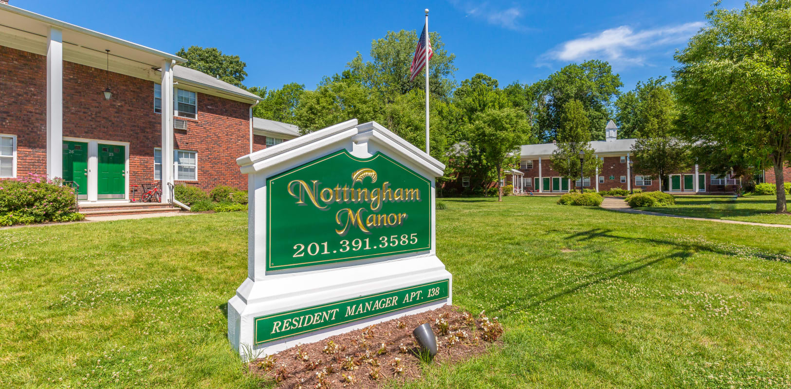 Nottingham Manor sign in front of apartments in the middle of large green lawn in Montvale, New Jersey