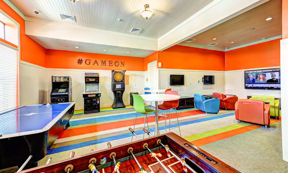 Air hockey, arcade games, and more in the game room at Hacienda Club in Jacksonville, Florida
