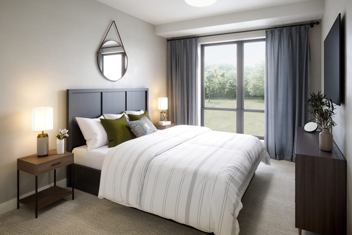 Bedroom decorated with bed, nightstand and dresser at Amira Minnetonka in Minnetonka, Minnesota.