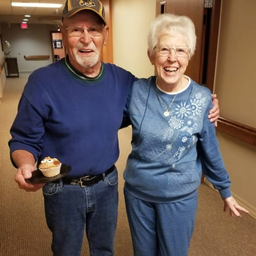 Residing couple walking the halls of The Oxford Grand Assisted Living & Memory Care in Wichita, Kansas