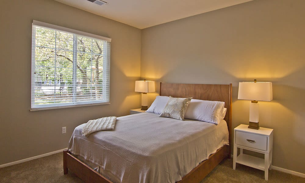 Beautiful bedroom at Perry's Crossing Apartments in Perrysburg, Ohio