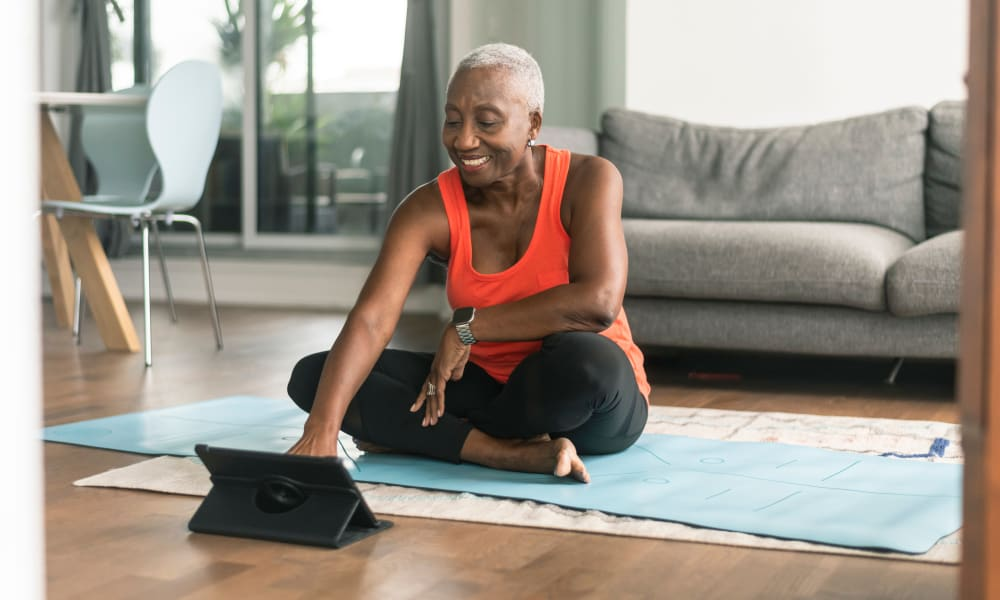 A resident doing yoga in her apartment at Mount Carmel Apartments in Mount Carmel, Pennsylvania