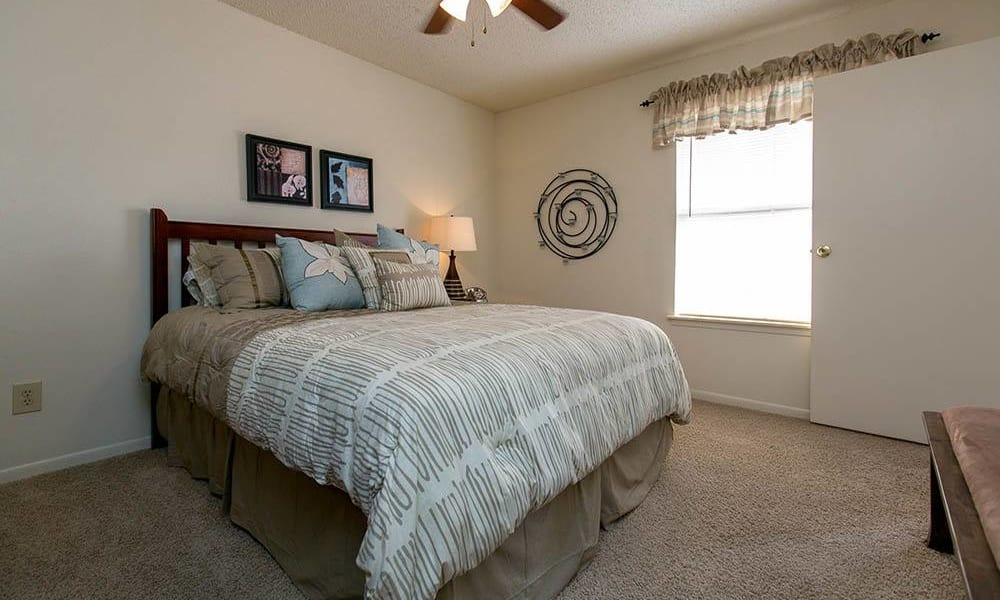 Cozy primary bedroom at Walnut Ridge Apartments in Corpus Christi, Texas